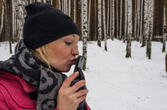 Sexy russian woman kisses her mobile phone Stock Photo