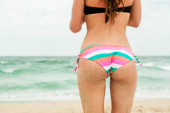 Sexy sandy woman buttocks Royalty Free Stock Images