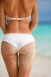 Sexy sandy woman buttocks on tropical beach background near ocean Royalty Free Stock Photography