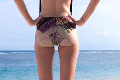 Sexy sandy woman buttocks on tropical beach of Bali island, background near ocean. Indonesia. Stock Photos