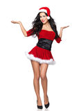 Sexy Santa. Beautiful and sexy woman wearing santa clause costume Royalty Free Stock Images