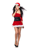 Sexy Santa. Beautiful and sexy woman wearing santa clause costume Royalty Free Stock Image