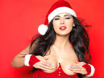 Sexy Santa. Beautiful and sexy woman wearing santa clause costume Stock Images