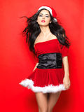 Sexy Santa. Beautiful and sexy woman wearing santa clause costume Stock Photos