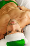 Sexy Santa in bed. Young sexy male model in green Santa hat and briefs laying in bed Stock Image