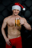 Sexy santa with beer. Royalty Free Stock Photo