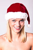 Sexy Santa Blond Girl. Portrait Of A Sexy Blond Girl Wearing A Santa Hat Stock Images