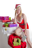 Sexy Santa with Christmas gifts Stock Photos
