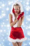 Sexy santa claus girl clapping hands Stock Image