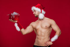 Sexy santa claus has surprise for you Royalty Free Stock Photography