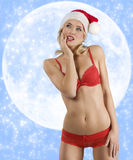 Sexy santa claus on the moon Royalty Free Stock Photography