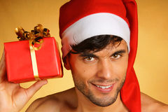 Sexy Santa Claus with present Stock Images