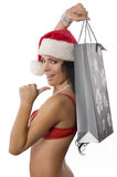 Sexy santa claus showing bag Royalty Free Stock Image