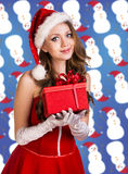 Sexy santa. Collage. Snow maiden in red dress, on dark blue background with stylized artistic snowflakes Stock Photo