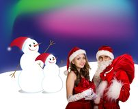 Sexy santa. Collage. Snow maiden in red dress, on dark blue background with stylized artistic snowflakes Stock Image