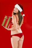 Sexy Santa Girl. With Christmas present Stock Image