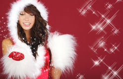 Sexy santa girl. Portrait of beautiful sexy girl wearing santa claus clothes on red background Stock Photos