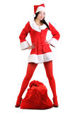 Sexy santa girl with a big bag of gifts Stock Photos