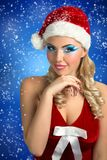 Sexy Santa Girl. Santa Girl. Card Happy New Year. Santa Claws girl with stylish hair-dress, hat, Christmas New Year party. Pretty curly woman. Close-up portrait Royalty Free Stock Photo
