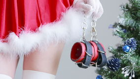 Sexy Santa Girl caresses herself. sex games. hands in handcuffs stock video