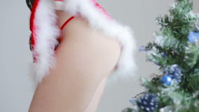 Sexy Santa Girl caresses herself. sex games. hands in handcuffs stock footage