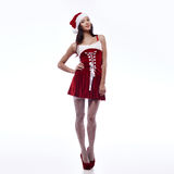 Sexy santa girl. Fashion portrait young brunette santa girl in full length Royalty Free Stock Image