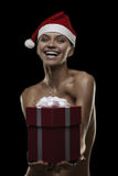 Sexy santa. Sexy girl with gift box and hat of santa, isolated ob black Stock Photography