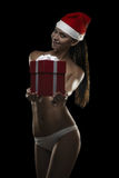 Sexy santa. Sexy girl with gift box and hat of santa, isolated ob black Stock Image