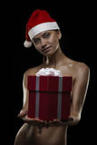 Sexy santa. Sexy girl with gift box and hat of santa, isolated ob black Stock Photos