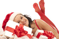 Sexy santa girl with gift boxes Stock Photos