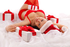 Sexy santa girl with gift boxes Stock Image