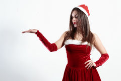 Sexy santa girl holding empty space for something or text, isolated on white background Royalty Free Stock Photo