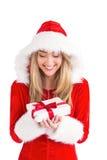 Sexy santa girl holding gift Royalty Free Stock Photos