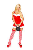 Sexy santa girl holding kettlebell. Isolated on white Royalty Free Stock Image