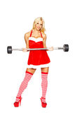Sexy santa girl holding olympic bar Stock Images