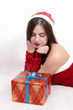 Sexy santa girl, lies at present on her elbows isolated on white Royalty Free Stock Images