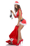 Sexy santa girl pulling out a pantie from her bag. On isolated white background Royalty Free Stock Photos