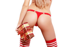 Sexy santa girl in red panties and stockings holding gift Royalty Free Stock Photo