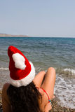 Sexy santa girl in the sea Royalty Free Stock Images