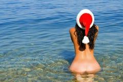 Sexy santa girl in the sea Stock Photos