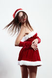 Sexy santa girl, turns and throws her hair, female isolated on a light background Royalty Free Stock Photos