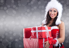 Sexy santa girl in white hat  holding a gift boxes Stock Photography