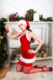 Sexy Santa Girl. Young beautiful woman lady model woman sexy Snow Maiden, decorate Christmas tree. Holidays new year Christmas. Perfect slim figure natural Royalty Free Stock Image