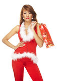 Santa helper. On white background holding a gift stock photography