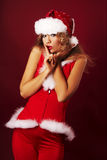 Santa helper. On red background stock photos