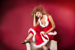 Santa helper. On red background royalty free stock photos