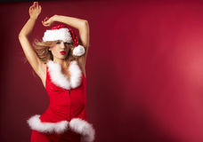 Santa helper. On red background royalty free stock photography