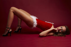 Santa helper on red background. Santa helper lie on red background royalty free stock photography