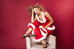 Santa helper. On red background royalty free stock photo