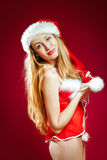 Sexy santa helper on red background Stock Photo